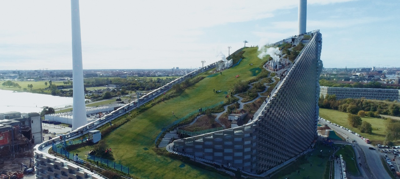 The BIG-designed waste-to-energy plant in Copenhagen with a ski-hill on top, image courtesy of ADFF