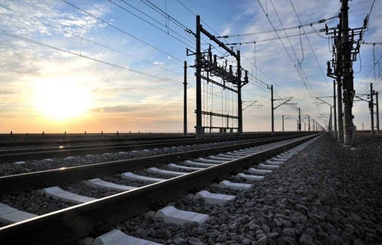 Photo of electric lines above railway tracks